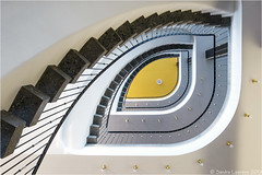 Yellow Eye (Sandra Lipproß) Tags: architecture architektur kassel circularstairs stairs staircase spiralstaircase stairwell treppe treppenhaus wendeltreppe spiral circular gelb yellow abstract abstrakt treppenauge