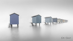 Osea Beach Huts (Nathan J Hammonds) Tags: sea seascape beach water huts osea christmas architecture nikon day tide fineart smooth calm minimal boxing simple 15mm ire