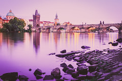 Sunset over Charles Bridge, Prague (Peter Szasz) Tags: peaceful prague praha czech republic tranquil travel sunset sky chill charles bright bridge karluv most vltava rocks reflection light path purple peace water wet magenta tower stones road rock tree calm colourful canon clear city building architecture old classic antique wideangle wide 80d 2470mm 2470 summer longexposure moody street stretching straight evening europe landscape line arch boats lamps statue windows clock clocktower bohemia