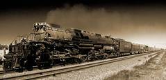 "DSC_7251  Union Pacific ""Big Boy"" #4014  EXPLORED (chief1120) Tags: unionpacific bigboy locomotive 4014 steam engine train mechanicsville ia iowa tracks up sepia outdoors bw machine outside transportation railroad railway freight passenger"