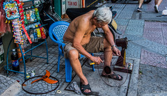 2019 - Vietnam - Ho Chi Minh City - 43 - Fan Repair (Ted's photos - For Me & You) Tags: 2019 cropped hochiminhcity nikon nikond750 nikonfx saigon tedmcgrath tedsphotos vietnam vignetting fan coolingfan streetscene street hcmc fanblade electricfan sandals male man oldman shorts wristwatch shirtless 1people