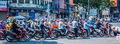 2019 - Vietnam - Ho Chi Minh City - 45 - Phù Đổng Six-Way Intersection (Ted's photos - Returns Early February) Tags: 2019 cropped hochiminhcity nikon nikond750 nikonfx saigon tedmcgrath tedsphotos vietnam vignetting streetscene street motorcycle motorcycles wideangle widescreen hcmc umbrella adoredress themokahotel themokahotelhcmc helmut helmuts g2000 peopleandpaths pathsandpeople people