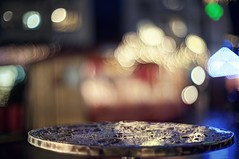 A glühwein and a bratwurst to warm up (PeterThoeny) Tags: chur switzerland alps swiss market christmas christmasmarket light outdoor night bokeh blur outoffocus sony sonya7 a7 a7ii a7mii alpha7mii ilce7m2 fullframe vintagelens dreamlens canon50mmf095 canon 3xp raw photomatix hdr qualityhdr qualityhdrphotography table rain drop fav100