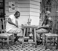 Amigos II (Bart van Hofwegen) Tags: friend friends friendship laugh laughing people men terrace drink drinking bar city citystreet citylife street streetphotography urban urbanphotography urbanlife málaga malaga blackandwhite monochrome