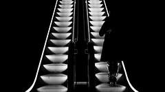 escalator (heinzkren) Tags: schwarzweis blackandwhite monochrome rolltreppe escalator stairs indoor canon eos canonr eosr woman frau treppe mystery magical street streetphotography candid vienna silhouette urban noiretblanc biancoetnero mood minimalism abstract