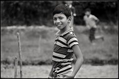 Teeth aren't pearly, until you smile! (Eddie.Rasheed) Tags: blackwhite monochrome portrait portraitphotography kids smile pose cricket kerala munnar mypixeldiary southindia travelogue playing incredibleindia nikonphotography nikon d3300