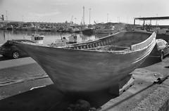 Perched Boat (IMG_0031mod) (AngusInShetland) Tags: almeria fishingboat decay boat wood andalucia andalusia spain vivitar28200f3553zoom europe dynax7000i analogue minolta maxxum 35mm ilford hp5 hp5400 canoscan5600f