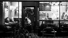 Time For Coffee 02 (byronv2) Tags: bruntsfield bruntsfieldplace edinburgh edimbourg edinburghbynight night nuit nacht scotland blackandwhite blackwhite bw monochrome cafe diner restaurant projectcoffee coffee window table seat sitting seated drinking eating peoplewatching candid street