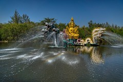 Sculpture and fountain in a lake in Muang Boran in Samut Phrakan, Thailand (UweBKK (α 77 on )) Tags: muang mueang boran ancient siam city open air museum garden park history historical culture heritage samut phrakan province bangkok thailand southeast asia sony alpha 77 slt dslr sculpture fountain water lake rainbow art installation