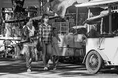 Inspecting the food carts (Beegee49) Tags: street people family filipina walking food carts blackandwhite monochrome sony a6000 silay city philippines asia bw happyplanet asiafavorites
