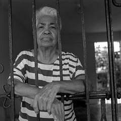 Behind Bars (Eddie La Mole) Tags: family portrait mamiyac330 mamiyasekor80 kodaktrix film 120 mediumformat 6x6 sunny16rule
