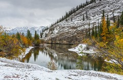 Somewhere along the highway (Photosuze) Tags: landscape canada jaspernationalpark pond water reflection sky clouds mountains trees autumn snow alberta