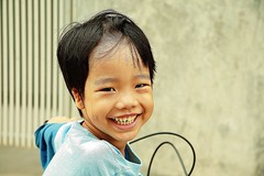 boy on a tricycle (the foreign photographer - ฝรั่งถ่) Tags: boy child tricycle khlong thanon portraits bangkhen bangkok thailand canon