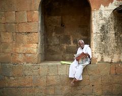 Old Man Reading the Papers (ckilger) Tags: leicam10 bangalore bengaluru ey indien bangalorefort summiluxm11450asph mann sitzend lesend zeitung mauer steine weis weishaarig