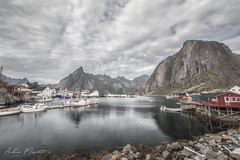 Hamnøy - Lofoten Islands (Norway) (Andrea Moscato) Tags: andreamoscato norvegia norge bokmål nynorsk north europe view vivid vista day light luce shadow ombre blue white red pontile porto history historic cielo sky water sea reflection riflesso building buildings architecture architettura art artist boat yacht house pier dock clouds nature natura nuvole natural naturale fiordo fiord mountain montagna mare landscape isola island bay lofoten harbor city città arte fishing village rock stones