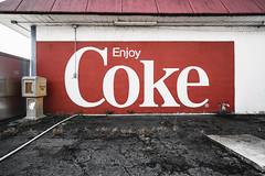 Don't Read Between The Lines (The Really Bad Photographer) Tags: wall rack pavement logo coke greenbrier arkansas 2019 usa nikon z7 nef raw lr urban brick