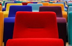 Rainbow auditorium (Mauro Hilário) Tags: artistic chairs colorful colour indoor belgium art symmetry symmetric red angle perspective creative composition