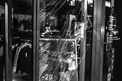 spider would do it better (* Jernej *) Tags: blackandwhite person people text signage bw monochrome street art streetart timeless time shadow black light white entrance door exit shop broken glass