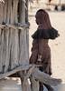 f03_Himba woman going home (maccdc) Tags: namibia kaokoland himba village