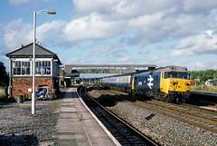 50029, Tiverton Junction, August 1985 (David Rostance) Tags: 50029 class50 signalbox railwaystation tivertonjunction devon motorcycle honda