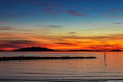 Il tramonto è un fenomeno intellettuale.- Sunset is an intellectual phenomenon.(Fernando Pessoa) (Eugenio GV Costa) Tags: approvato tramonto isole roccie rock islands acqua outside sole colori sun colors mare sunset cielo sky sea water