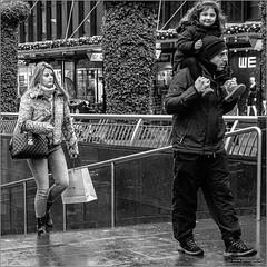 We (John Riper) Tags: johnriper street photography straatfotografie rotterdam square bw black white zwartwit mono monochrome netherlands candid john riper fujifilm xt3 people father man kid eye contact smile fun lacoste bag beurstraverse koopgoot oldenbarneveltstraat xf35mmf2 rain wet pavement stairs chess nikkie fashion