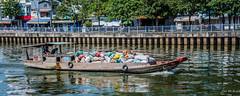 2019 - Vietnam - Ho Chi Minh City - 61 - River Scow (Ted's photos - Returns Early February) Tags: 2019 cropped hochiminhcity nikon nikond750 nikonfx saigon tedmcgrath tedsphotos vietnam vignetting reflection river hcmc boat railing umbrella riverside water waterreflection hcmcriver wideangle widescreen