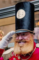 Portrait Of Holiday Greeter at FAO Schwartz, Rockefeller Center Manhattan (nrhodesphotos(the_eye_of_the_moment)) Tags: dsc36333001084 wwwflickrcomphotostheeyeofthemoment theeyeofthemoment21gmailcom greeter holidayseason faoschwartz rockefellercenter portrait hat uniform storegreeter season winterseason man salute manhattan nyc outdoors