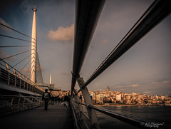 Crossing (Through_Urizen) Tags: architecture category hdr halic istanbul places turkey canon1585mm canon70d canon skyline cityscape station bridge architecturephotography travelphotography lined lines patterns tower galatatower goldenhorn city buildings people