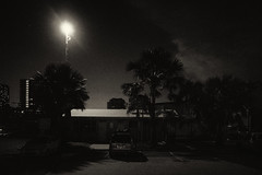untitled (ChrisRSouthland (mostly off, traveling & working)) Tags: darwin griii ricohgriii night nightphotography bw blackandwhite monochrome schwarzweiss tropical palmtree building roof streetlight