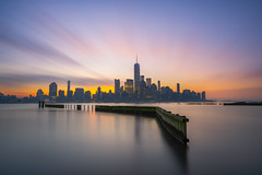 Freedom Tower from Newport, Jersey City (Mike Ver Sprill - Milky Way Mike) Tags: freedom tower newport pier pilings cityscape landscape hudson river new jersey city long exposure buildings lower manhattan moving clouds sunrise sunset outdoors reflections beautiful calm moody dawn dusk explore gorgeous nj nyc york