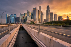 Esplanade Bridge (Scintt) Tags: singapore wideangle traditional city cityscape hall marinabay rafflesplace tanjongpagar financial cbd central business district offices towers skyscrapers skyline sky clouds sun light contrast blue tones travel tourism architecture buildings urban modern exploration steps waterfront scintt scintillation jonchiangphotography fullerton bridge hotel expensive processed neutraldensity sony a7rii 1635 golden reflection clear sunset dusk evening traffic iconic flare starburst hny