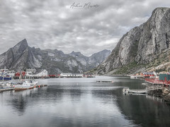Hamnøy - Lofoten Islands (Norway) (Andrea Moscato) Tags: andreamoscato norvegia norge bokmål nynorsk north europe view vivid vista day light luce shadow ombre blue white red pontile porto history historic cielo sky water sea reflection riflesso building buildings architecture architettura art artist boat yacht house pier dock clouds nature natura nuvole natural naturale fiordo fiord mountain montagna mare landscape isola island bay lofoten harbor city città fishing village