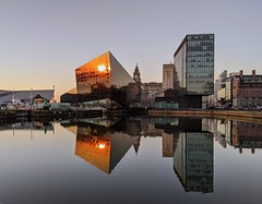 Evening reflections in the docks at Liverpool (Tony Worrall) Tags: liverpool merseyside mirror serene scenic architecture building wetreflection reflections shapes geometric wet water evening beauty nice dailyphoto photograff photohour lines reverse welovethenorth nw northwest north update place location uk england visit area attraction open stream tour country item greatbritain britain english british gb capture buy stock sell sale outside outdoors caught photo shoot shot picture captured ilobsterit instragram office golden sunlit pattern