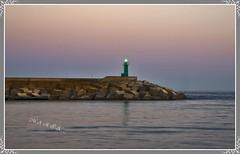 Mi querida España, que su luz nos guie siempre (<<<María>>>) Tags: mar cielo faro luz alicante óceano piedras malecón agua water