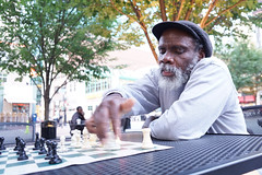 Chess Man on the streets of Pittsburgh (lad49) Tags: streetphotography chess hats colorstreetphotography pittsburgh motion beard whitebeard