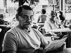 Two glances (Aurélien B.) Tags: street buenosaires photo monochrome people city coffee diary post journal moustache glasses glance guy gentleman read reader reading paper newspaper news blackandwhite sitted sit seat noiretblanc noir et blanc
