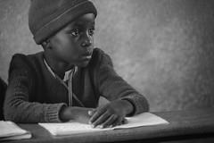Words.. (u c c r o w) Tags: maasai africa african school student portrait boy kid blackandwhite arusha tanzania notebook people lesson