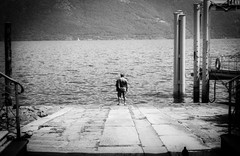 I see a little silhouetto of a man (_LWR_) Tags: 35mm analog film ilforddelta100 leicam6 rodinal street streetphotography strand strkng leica ilford delta 100 bw blackandwhite sw schwarzweis italy lagomaggiore