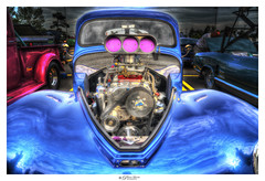 The Face Of A Ford Custom Antique Rod (Pearce Levrais Photography) Tags: auto automobile hotrod sportscar portrait ford car photoshop outside artwork display outdoor sony racing hdr carshow ilce7rm3 a7r3 engine supercharger chrome custom customize customized blue turbo turbocharged