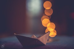 ~ Borne with the invisible and creeping wind,Draw the huge bottoms through the furrow'd sea,Breasting the lofty surge. (Fire Fighter's Wife) Tags: redux2019 redux retro vintage matte muted soft dreamy tabletopstilllife tabletop lp vinylrecord closeup macro 60mm nikond750 nikon 45 record bokeh origami paperboat boat hmm happymacromonday's macromonday's happymacromonday macromonday stationery