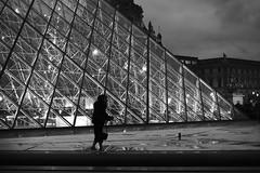 On the parapet (pascalcolin1) Tags: paris femme woman pyramide pyramid lumière light nuit night parapet eau water reflets reflection photoderue streetview urbanarte noiretblanc blackandwhite photopascalcolin 50mm canon50mm canon