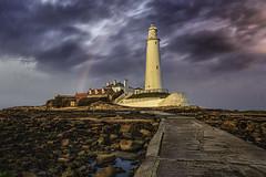 Be my guide (Caleb4Ever) Tags: lighthouse stmaryslighthouse northeast rainbow rain landscape caleb4ever rocks sky outdoors national stmarysislandcauseway whitleybay
