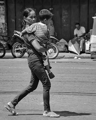 Too tired to walk? (Beegee49) Tags: street people woman child carrying blackandwhite monochrome sony bw a6000 bacolod city philippines asia
