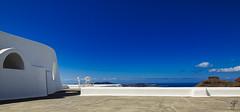Chairs of Santorini no.2 (Bela Bodo) Tags: santorini chair wall sky cloud sun see blue yellow white shadow space weekend travel