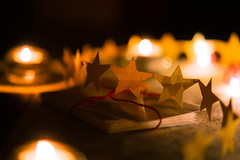 Share the Light (Nathalie_Désirée) Tags: christmas celebration atmosphere atmospheric beautiful style darkness night light candlelight star starlet small paper ornament handcrafted sonyαmo sonyalpha7r2 sonyalpha7rii samyang85mmf14 form forms golden evening indoors livingroom magic