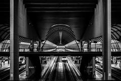 Symmetry Justa (Robin Kelderman) Tags: station railwaystation blackandwhite sevilla seville espana spain train trainstation
