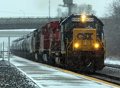 CSXT 8099 (Jonah Arndt) Tags: snow train csx csxt sd402 emd sky clouds tracks platform station rocks rail