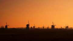 One more dawn, one more day, one more year...          HAPPY 2020! (Michael Kalognomos) Tags: landscape photography windmill dawn cinematography kinderdijk holland netherlands newday happynewyear 2020 mills colors colorful minimalism minimal horizon calmness sony sony1650mmf3556oss sonya6400 sonyalpha travelphotography unesco red orange sky sun sunrise fog