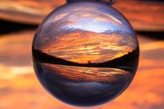 IMG_4630-2 (richardbrunton) Tags: sunset crystal ball lens reflection oranges yellows redsblue sky